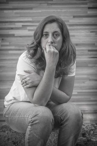 Sad_woman_looking_at_camera.jpg