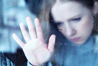 depressed woman in the rain.jpg